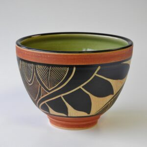 Hand carved pottery serving bowl